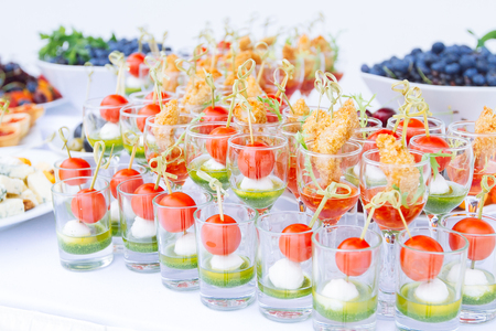 Beautifully decorated catering banquet table with different food snacks and appetizers Reklamní fotografie