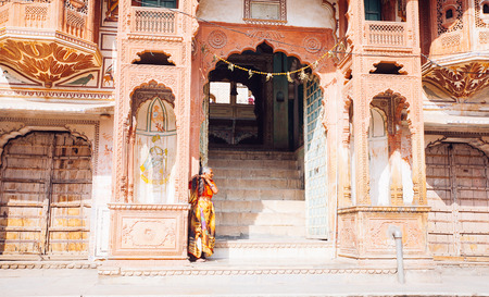 PUSHKAR, INDIA - JAN 16, 2017 Woman standing on the street in india in Pushkar, Rajasthan. Editorial