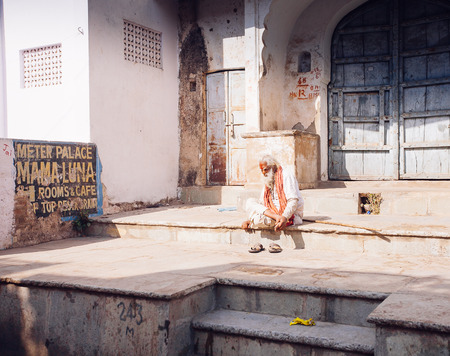 PUSHKAR, INDIA - JAN 16, 2017 Man sitting on the street in india in Pushkar, Rajasthan. Editorial