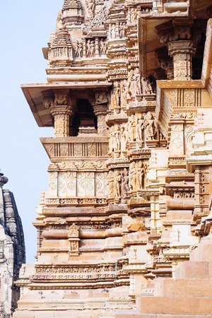Ancient bas-relief at famous temple in Khajuraho, India. Unesco World Heritage Site Stock Photo