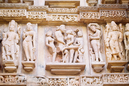 Ancient bas-relief at famous erotic temple in Khajuraho, India. Unesco World Heritage Site Reklamní fotografie