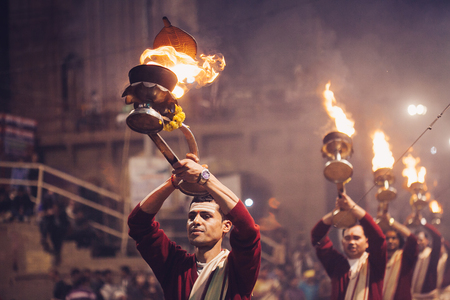 VARANASI, INDIA- 23 JANUARY 2017 : A Hindu priest performs the Ganga Aarti ritual in Varanasi. Fire puja is a Hindu ritual that takes place at Dashashwamedh Ghat on the banks of the river Ganges