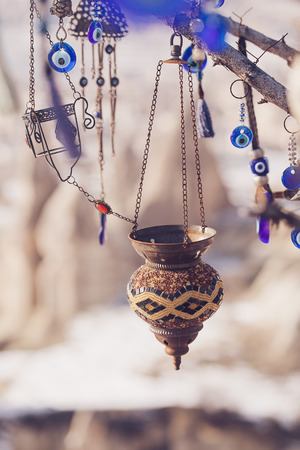 Nazar, charms to ward off the evil eye , on the branches of a tree in Cappadocia, Turkey Stock Photo
