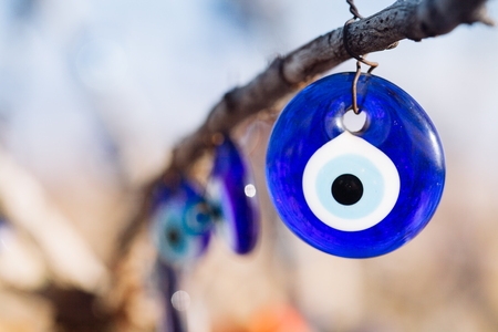 Nazar, charms to ward off the evil eye , on the branches of a tree in Cappadocia, Turkey Stockfoto