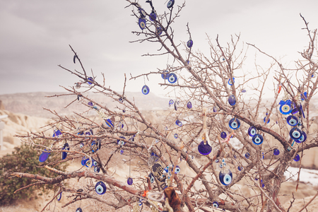 Nazar, charms to ward off the evil eye , on the branches of a tree in Cappadocia, Turkey Banque d'images