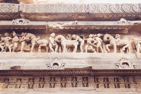 Ancient bas-relief at famous erotic temple in Khajuraho, India. Stok Fotoğraf