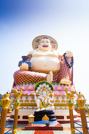 Smiling Buddha of wealth statue on Koh Samui island, Thailand