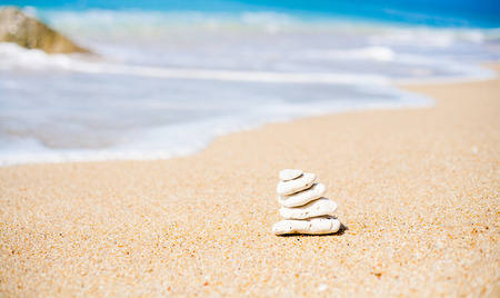 Stack of round stones on a seashore Stockfoto