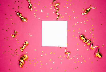 Golden decorations and sparkles on bright  pink background