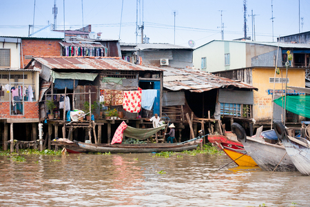 JAN 28 2014 - MY THO, VIETNAM - Houses by a river, on JAN  28, 2014, in  Mekong Delta, Vietnam Editorial