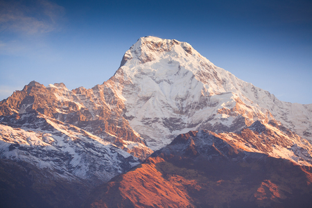 Sunrise in Annapurna area mountains in the Himalayas of Nepal Stock Photo