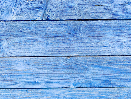 Vintage wood blue background with peeling paint