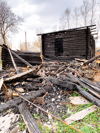 Burnt wooden house. Consequences of fire.