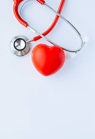 Stethoscope and red heart on white background. Cardiology and Healthcare concept