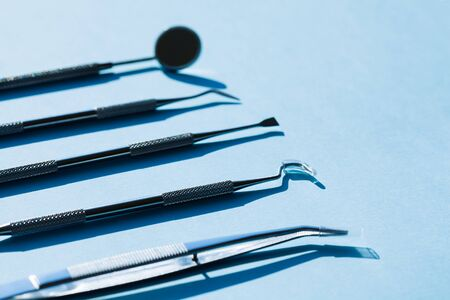 dentist tools on blue background: Dental Hygiene and Health conceptual image