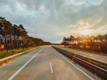 Asphalt road and beautiful nature landscape at sunset