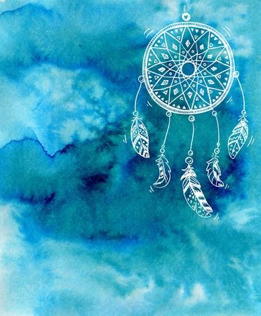 青い水彩背景に描かれたドリーム キャッチャーを手します。