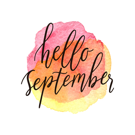 Hello september calligraphic phrase on a watercolor texture circle background