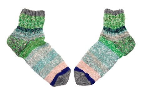 Two wool knitted socks isolated on white Stock Photo
