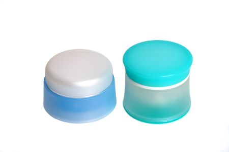 Two jars with cosmetics on a white background