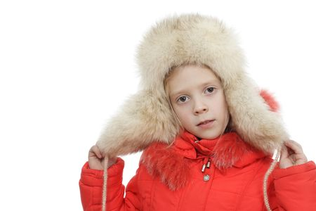 The girl in a fur cap on a white background