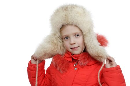 The girl in a fur cap on a white background Stock Photo