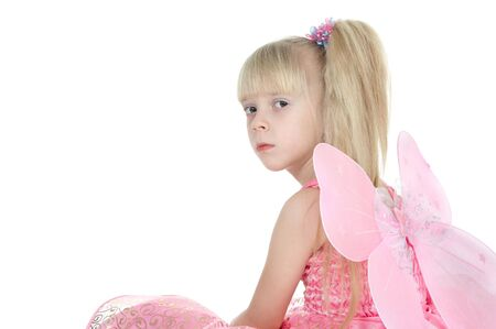 The girl in a pink dress with wings on a white background