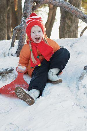 The girl on a snow joyfully shouts