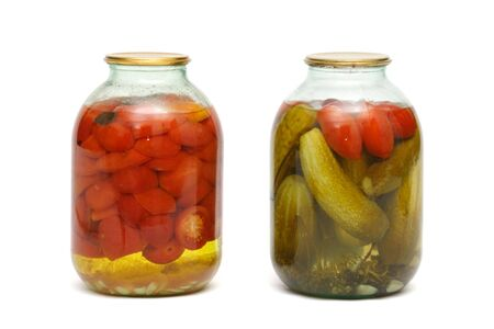 2 banks with pickles and tomatoes on a white background Stock Photo - 4045985