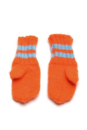 1 pairs childrens knitted mittens on a white background Stock Photo