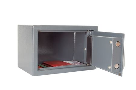 The open safe with documents on a white background