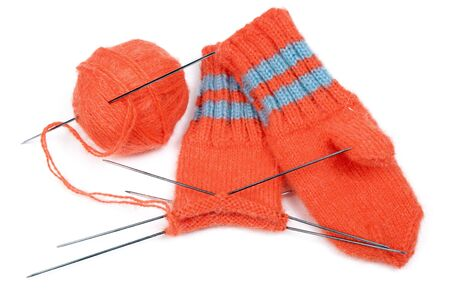Childrens mittens and ball of a wool with spokes for knitting