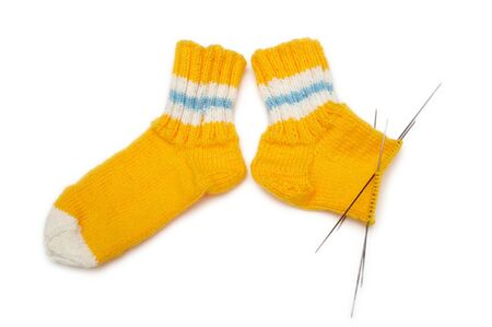 Two wool knitted socks isolated on white