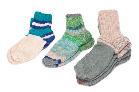 Different woolen socks on a white background