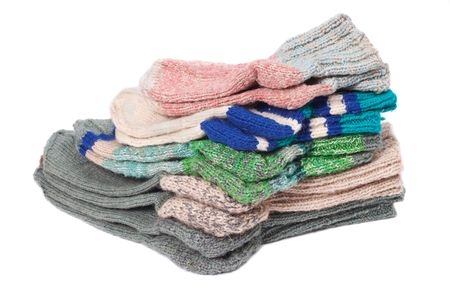 Pile of woolen socks on a white background