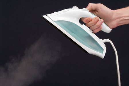 smoothing iron on a dark background