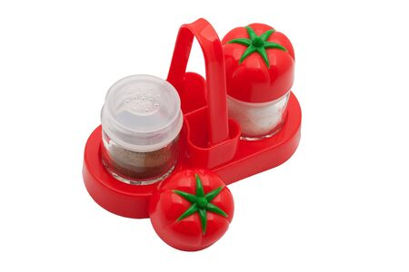 The complete set of a saltcellar and pepperbox in a red support Stock Photo - 4045987
