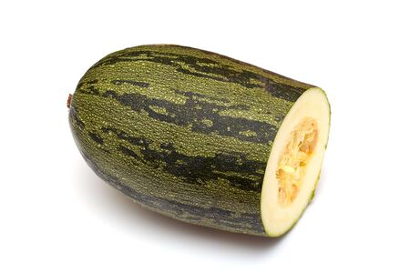 The cut vegetable marrow on a white background