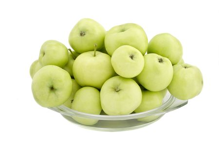 Green apples in a glass plate on a white background Stock Photo - 4045977