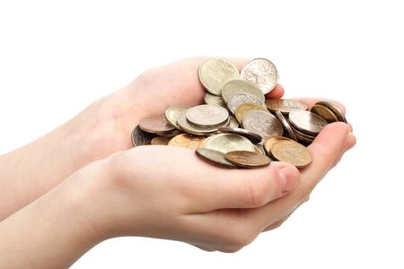 Handful of coins in childrens palms are isolated on a white background photo