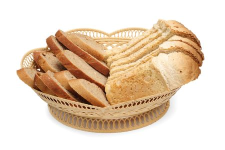 White and grey bread in a basket are isolated on a white background photo