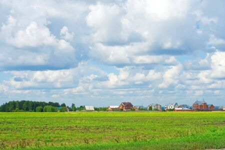 Suburban housing development encroaching on farm fields