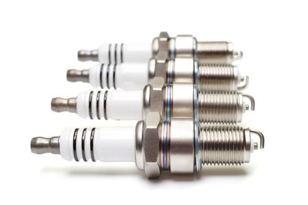 Spark plugs are isolated on a white background Stock Photo - 6053529