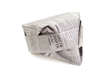 Paper hat from the newspaper it is isolated on a white background
