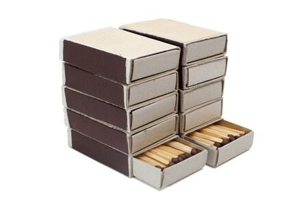Pile of cardboard matchboxes with matches on a white background