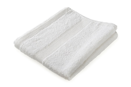 The white terry towel is isolated on a white background