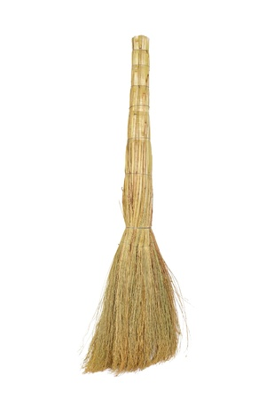 The broom for sweeping dust is isolated on a white background