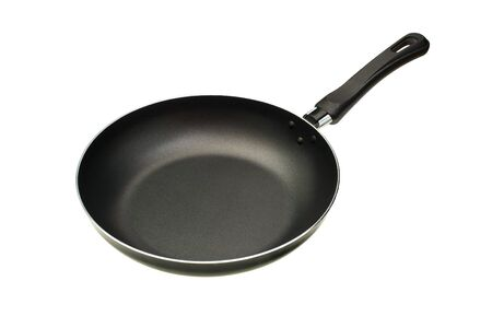 The black frying pan is isolated on a white background Stock Photo