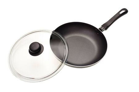 Frying pan with a glass cover it is isolated on a white background