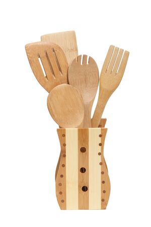 Set of wooden kitchen utensils it is isolated on a white background Stock Photo